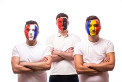 France, Albania, Romania Football fans of national teams with crossed hand look at camera on white background. European 2016 football fans concept.