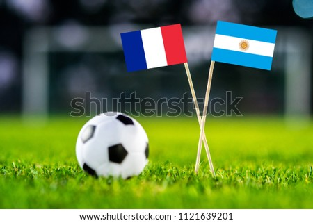 France and Argentina National flag - green grass and football ball. Round of 16. #1121639201