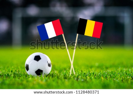 France and Belgium national flags on green football grass.  Semifinal. 11. July, Football match. #1128480371