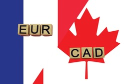 France and Canada currencies codes on national flags background. International money transfer concept