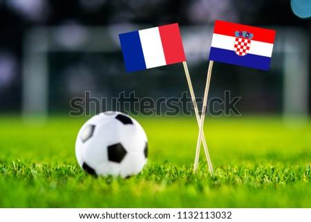FRANCE and CROATIA national Flag on football green grass. France - Croatia, FINAL OF World Cup, Russia 2018 #1132113032