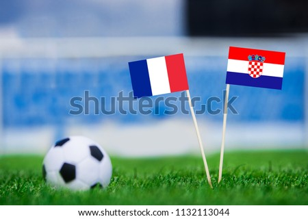 FRANCE and CROATIA national Flag on football green grass. France - Croatia, FINAL OF World Cup, Russia 2018  #1132113044