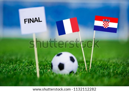 """FRANCE and CROATIA national Flag on football green grass. White table with tittle """"FINAL"""" France - Croatia, FINAL OF FIFA World Cup, Russia 2018 #1132112282"""