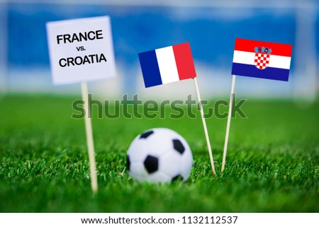 """FRANCE and CROATIA national Flag on football green grass. White table with tittle """"FRANCE vs. CROATIA""""  #1132112537"""
