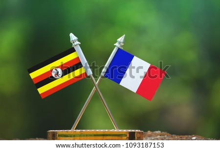 France and Uganda small flag with blur green background #1093187153