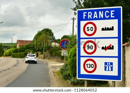 France border signboard. Sign of Speed limits at the border of France. #1128064052