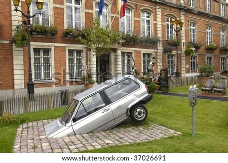France, Boulogne Sur Mer, old cars in a strange garden