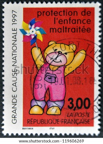 FRANCE - CIRCA 1997: A postage stamp printed in France shows a teddy bear, commemorating the protection of abused children, circa 1997.
