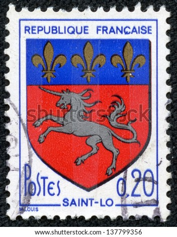 """FRANCE - CIRCA 1966: A stamp printed in France from the """"Arms of French Towns 6th Series"""" issue shows Saint-Lo coat of Arms, circa 1966."""