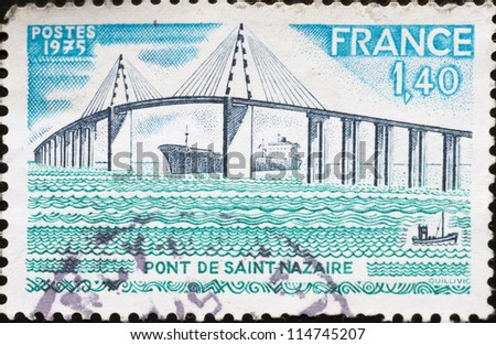 "FRANCE - CIRCA 1975: A stamp printed in France,shows image of  ""Saint-Nazaire"" Bridge,circa 1975."