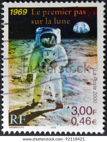 FRANCE - CIRCA 2000: A stamp printed in France shows the first man on the moon, Neil Armstrong, circa 2000