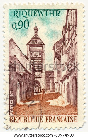 FRANCE - CIRCA 1971: A stamp printed in France shows Tower and street, Riquewihr, circa 1971