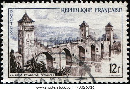 FRANCE - CIRCA 1955: A stamp printed in France shows Valentre Bridge (le Pont Valentre) in the town of Cahors, France,  circa 1955