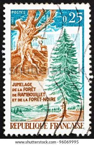 FRANCE - CIRCA 1968: a stamp printed in the France shows Gnarled Trunk and Fir Tree, Twinning of Rambouillet Forest in France and the Black Forest in Germany, circa 1968 - stock photo