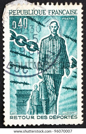 FRANCE - CIRCA 1965: a stamp printed in the France shows Returning Deportees, 1945, 20th Anniversary of the Return of People Deported during WWII, circa 1965