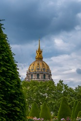 France. Cloudy summer evening in Paris. View of the Hotel Invalides from the Garden of the Rodin Museum
