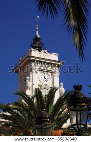 France Corsica Ajaccio City hall clock tower framed by palm fronds