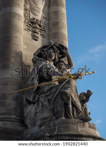 France de la Renaissance woman lady with golden gilded sword statue sculpture on Pont Alexandre III Paris France Stock photo ©