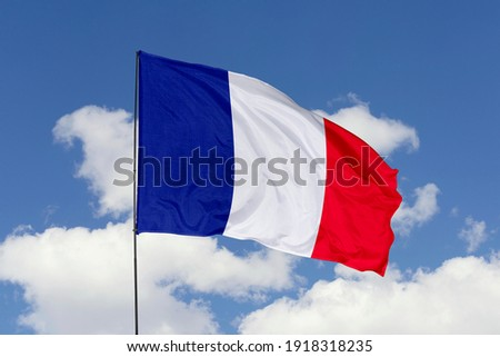 France flag isolated on the blue sky with clipping path. close up waving flag of France. flag symbols of France.