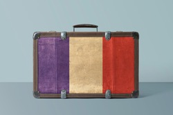 France flag on old vintage leather suitcase with national concept. Retro brown luggage with copy space text.