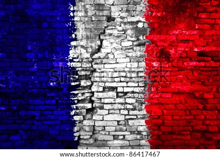 France flag painted on old brick wall
