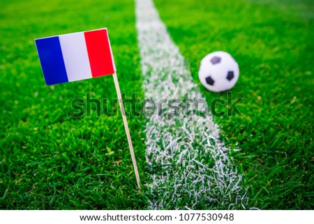 France national Flag and football ball on green grass. Fans, support photo, edit .  #1077530948