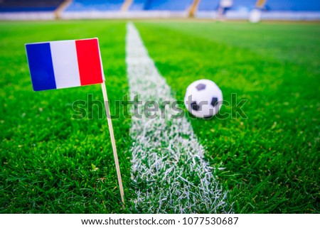 France national Flag and football ball on green grass. Fans, support photo, edit space.  #1077530687