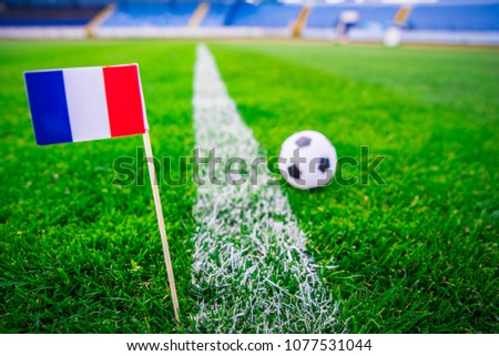 France national Flag and football ball on green grass. Fans, support photo, edit space.  #1077531044