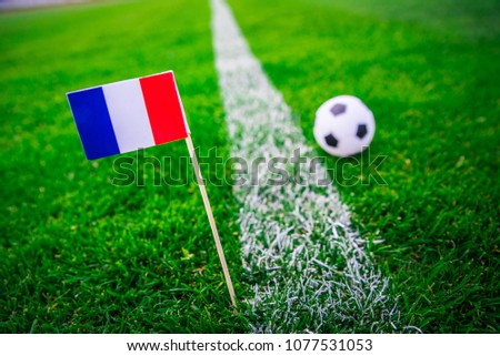 France national Flag and football ball on green grass. Fans, support photo, edit space.  #1077531053