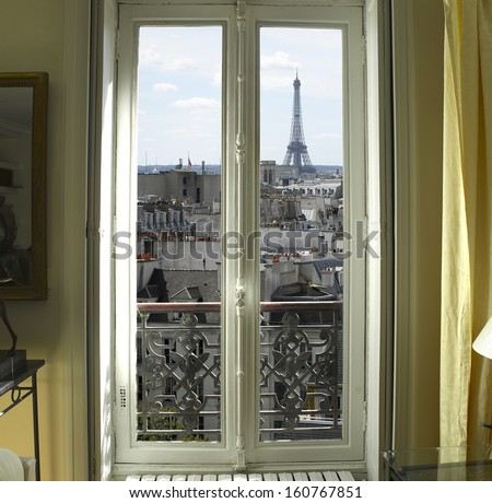 France Paris Window with Eiffel tower and roofs view