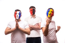 France - pray, Albania - serious, Romania â?? win. Football fans of national teams with crossed hand look at camera on white background. European 2016 football fans concept.