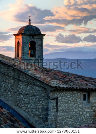 France, Provence, Lacoste. Church bell tower at sunset in the hill town of Lacoste.