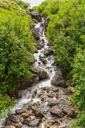 France. Region of Rhône-Alpes. Department of Savoy. Waterfall at the Cormet de Roselend. The Cormet de Roselend (1967 meters - 6453 ft above sea level) is a mountain pass in the French Alps.