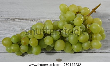 France, Rhone/Alps, Ferney Voltaire, October 2017:  Bunch of white grapes from France on a gray background #730149232