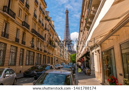 France. Summer Paris. Sunny day. Many cars on the narrow street. Eiffel Tower in the background