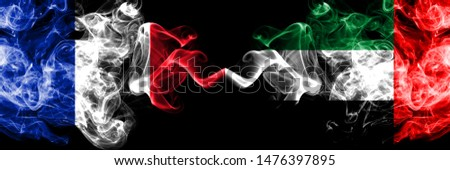 France vs United Arab Emirates, Emirati smoky mystic flags placed side by side. Thick colored silky abstract smokes banner of French and United Arab Emirates, Emirati