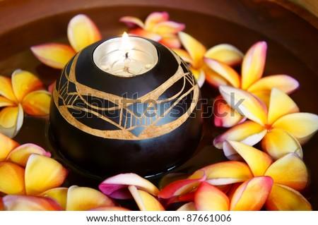 frangipani flower and aromatheraphy candle