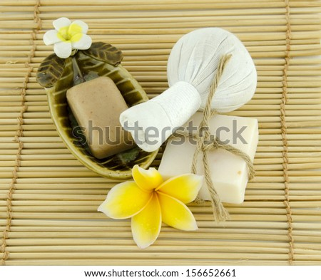 Frangipani, yellow, red Frangipani flowers and spa stones with flowers placed on the floor and white.