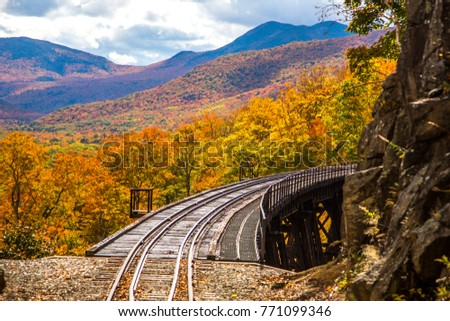 Frankenstein Trestle and the White Mountain National Forest. View from the Conway Scenic Railway on the Crawford Notch route, near Bartlett, New Hampshire.  Hardwood trees are showing peak fall color.