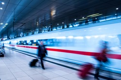 Frankfurt Airport Train station with blur business people movement in rush hour