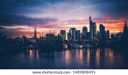 Frankfurt am Main Scenic Summer Sunset. Downtown Financial District Skyline Water illumination. Frankfurt, Hesse State Germany.