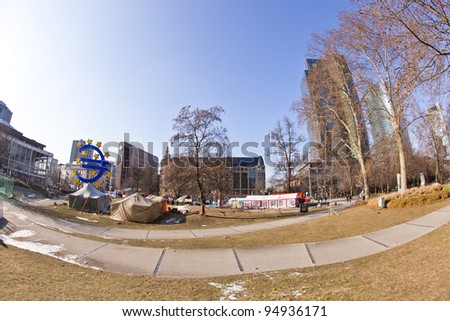 FRANKFURT - FEB 12: Protest camp of the Occupy Frankfurt movement (background) at the European Central Bank on Feb.12, 2011 in Frankfurt, Germany. It is part of the global Occupy Wall Street movement.
