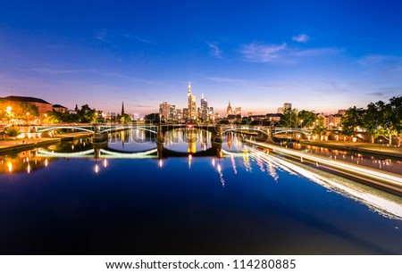 Frankfurt financial European city at night reflecting in the river