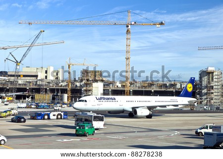 FRANKFURT, GERMANY - AUG 25: Lufthansa Flight ready to head to runway on August, 25, 2011 in Frankfurt, Germany. New Terminal A is under construction for airport enlargement,