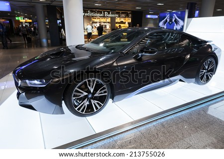 FRANKFURT, GERMANY - AUGUST 28, 2014: Photo of black BMW series i8 innovation car. Advertising stand in the passenger terminal, airport of Frankfurt