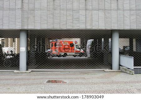 FRANKFURT, GERMANY - FEBRUARY 19: An ambulance of the Samaritan organization behind the bars of a fire department entrance on February 19, 2014 in Frankfurt / Emergency access road