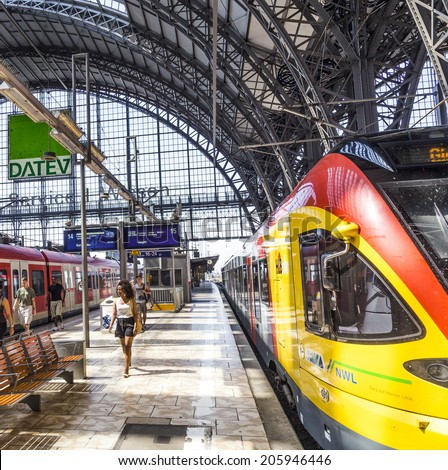 FRANKFURT, GERMANY - JULY 19, 2014: people Inside the Frankfurt central station in Frankfurt, Germany. With about 350.000 passengers per day its the most frequented railway station in Germany.