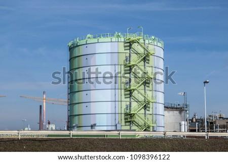 FRANKFURT, GERMANY - MAR 6, 2013: Industry park in Frankfurt hoechst with    tank  under blue sky #1098396122