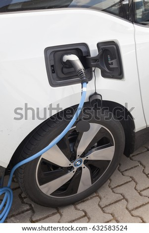 Frankfurt, Germany - March 30, 2017: BMW i3 electric vehicle at a charging station #632583524