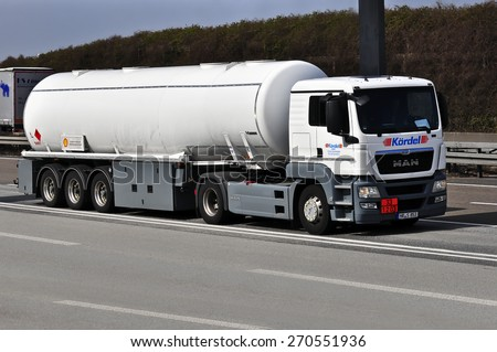 FRANKFURT,GERMANY-MARCH 28:MAN oil truck on the highway on March 28,2015 in Frankfurt,Germany. MAN SE, formerly MAN AG, is a German mechanical engineering company and parent company of the MAN Group.